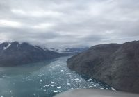 This the approach east of Narsarsuak Greenland. flying in the fjord over turqoise blue water and mountains both sides.